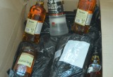 В Череповце в канализацию выльют 160 бутылок виски и водки