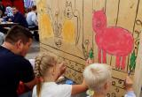 Харовчане раскрасили деревянную «Мегараскраску» по мотивам Василия Белова